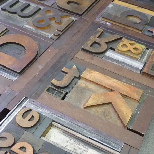 Wooden type blocks set in printer