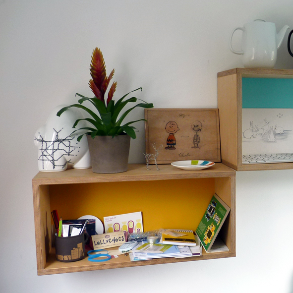 Box-shelves with turquoise and yellow backing