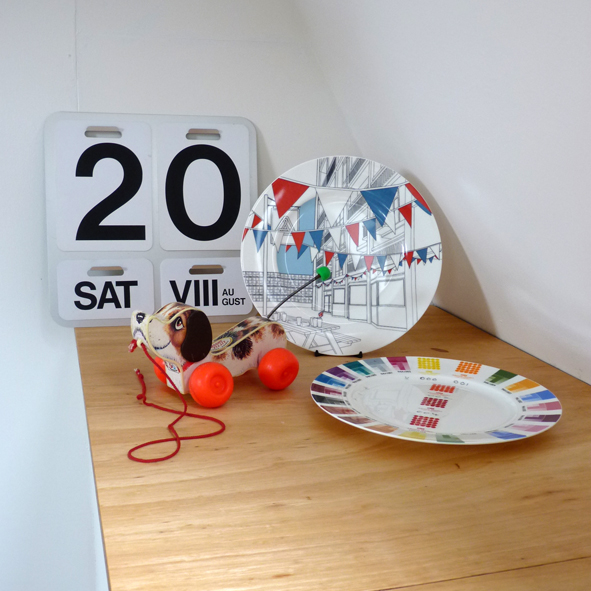 Oversized calendar, PWANP plates and vintage pull along dog