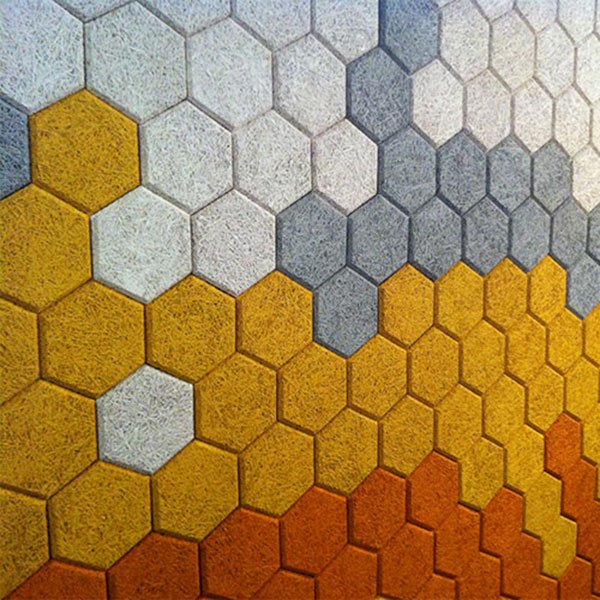 orange yellow grey and white hexagons making up a wall covering